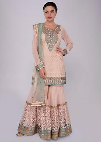 Cream self thread embroidered sharara suit set with mint green net dupatta only on Kalki