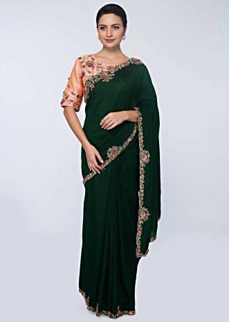 Rama green silk saree with floral embroidered  butti and border
