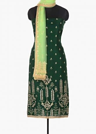 Rama green silk unstitched suit enhanced with gotta patch and moti work