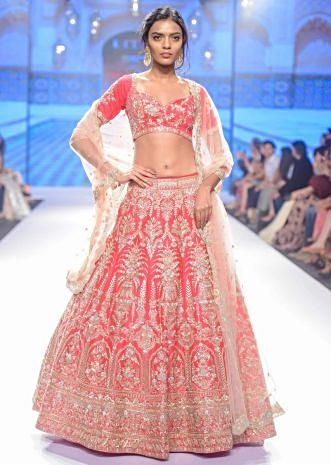 Rani pink raw silk embroidered lehenga set with peach net dupatta
