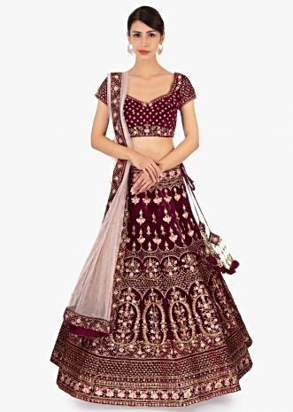 Red  velvet lehenga set paired with pink net dupatta