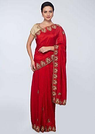 Red cotton silk saree in embroidered butti and border