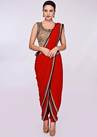Red lycra dhoti saree paired with fancy fabric blouse