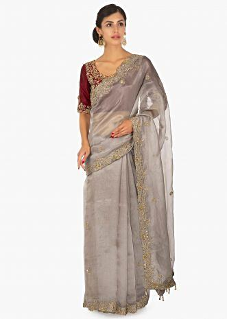 Red raw silk embellished blouse  paired with grey organza saree