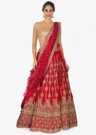 Red raw silk lehenga in sequins and zari along with a matching  net dupatta