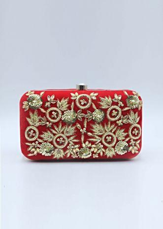 Red sling clutch bag embellished in zardosi floral embroidery
