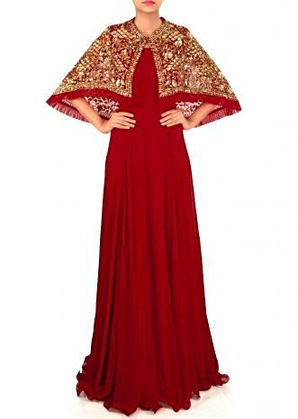 Red suit matched with embroidered cape in sequin only on Kalki