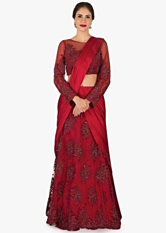 Red saree lehenga in satin and net embellished using moti and chord work only on Kalki