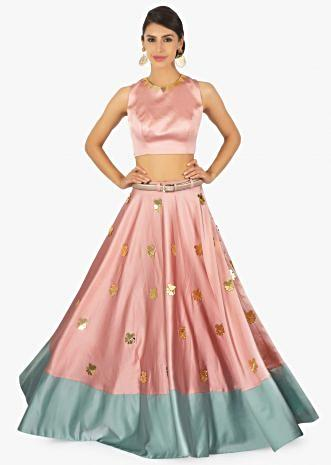 Rose pink crop top pared with a rose pink and turq green skirt