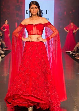 f8f120ae2f386c Ruby red heavy embroidered net lehenga with fancy off shoulder blouse with  long fared sleeves only ...