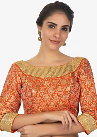 Rust brocade blouse in sequins and zari jewel neckonly