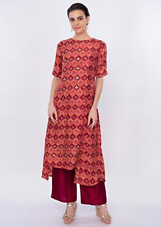 Rustic coral silk suit in batik print only on Kalki