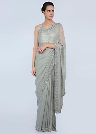 94f9ec7085 Sage green shimmer chiffon saree adorn with moti scattered and heavy stone  embroidered border only on ...