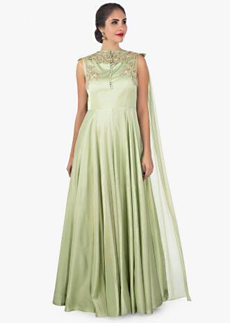 Sandal door green georgette satin gown enhanced with a attachable cape only on Kalki