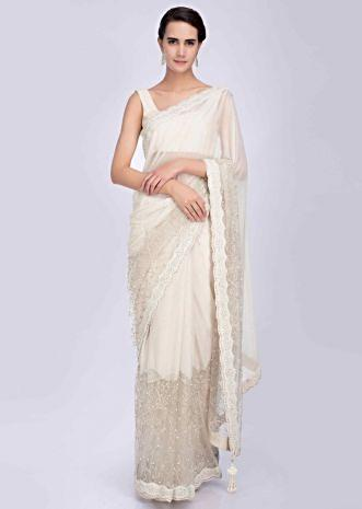 6b2523655f Scallop embroidered half and half ivory saree featuring in net and shimmer  lycra only on Kalki