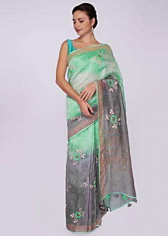 Sea green and grey shade cotton saree in  floral  butti