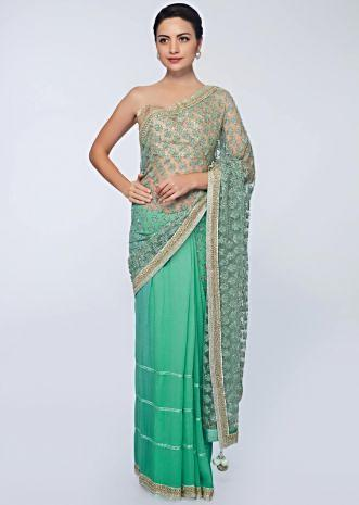 Sea green half and half saree featuring in net and chiffon