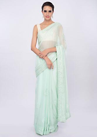 Sea green lucknowi embroidered georgette saree only on Kalki