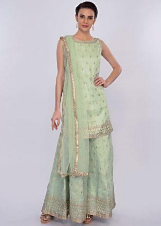 Sea green organza palazzo suit set in kundan embroidered butti only on Kalki