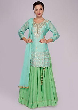 Sea green top matched with cotton skirt adorn in zari and gotta patch work