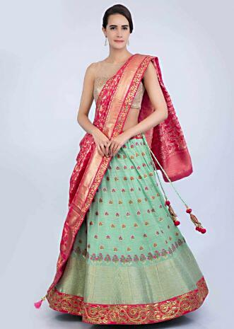 de9aacc12bb Sea green weaved georgette lehenga paired with a contrasting red dupatta  only on Kalki ...