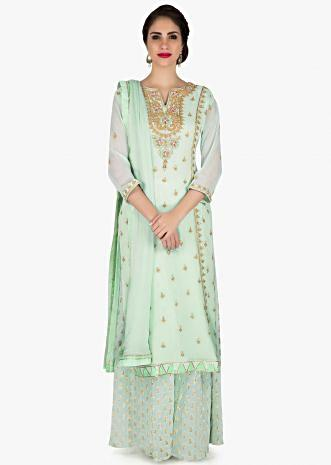 Sea green palazzo suit in georgette with embroidered neckline and butti all over only on Kalki