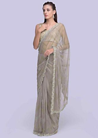 88d2a790414c18 Sheer net grey saree embellished with cut dana and stone detailing only on  Kalki