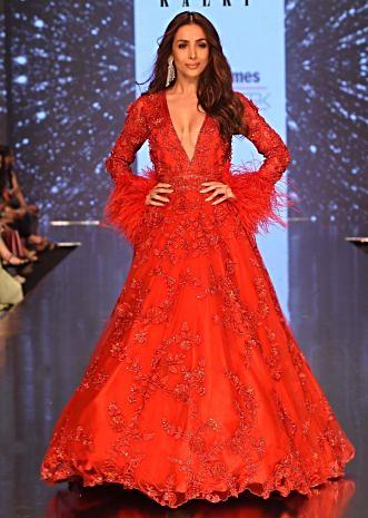 3ebe7eea7fe5 Showstopper Malaika Arora in Kalki's Ruby Red Embroidered Net Gown with  Feather Sleeves ...