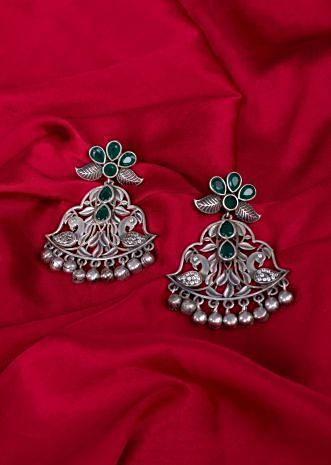 Silver coated oxidized earring with cut outs only on Kalki