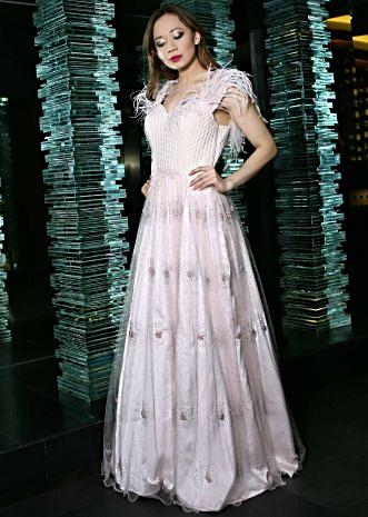 Baby pink shimmer gown in shimmer net with fancy feather sleeve only on Kalki