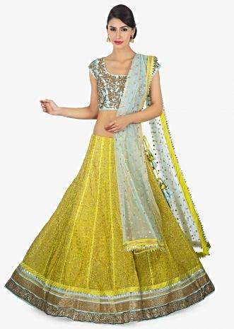 Sky blue raw silk embellished blouse paired with a canary yellow georgette lehenga and net dupatta