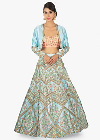 Sky blue raw silk lehenga and jacket along with a peach tube top