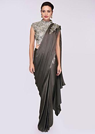 Smoke grey crepe satin draped saree paired with paired with cloud grey net embroidered blouse