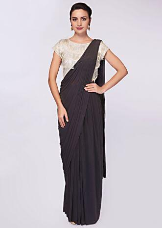 Smoke grey draped lycra saree paired with tasseled embroidered  blouse