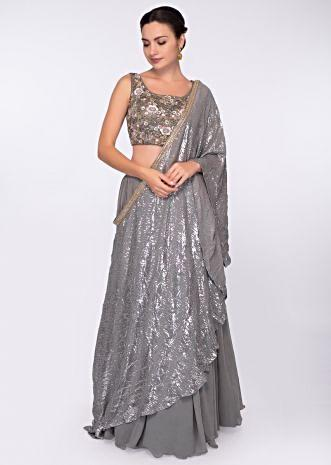Smoke grey georgette skirt paired with embroidered net top and grey chiffon wrap around