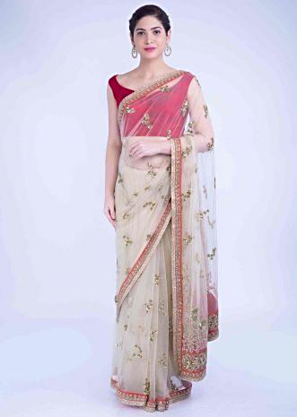 0b2f5839dc Tan beige net saree with coral orange raw silk blouse piece only on Kalki