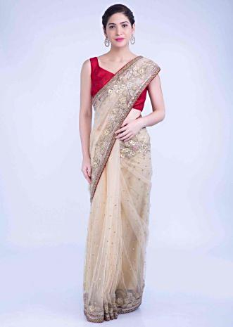 27516100f8 Tan beige net saree with red raw silk border only on Kalki