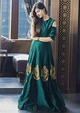 Teal green gown with cold shoulder and sequin butti only on Kalki