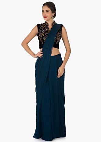Teal blue ready stitched saree and blouse adorn in cut dana and moti embroidery work only on Kalki