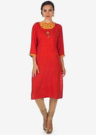 Tomato red kurti in with fancy neckline in buttons and tassel only on Kalki