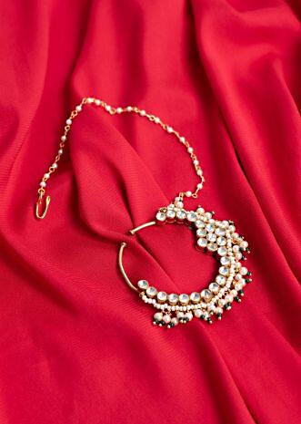 Traditional bridal nose pin with extended moti chain only on Kalki