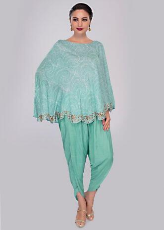 Turq blue dhoti pant paired with cape top in print and scallop border