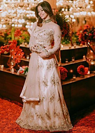 Kishwer Merchant in kalki golden net lehenga set with 3 D flower embroidery