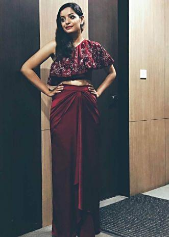 Lisa Mishra in Kalki maroon cape matched with drape skirt
