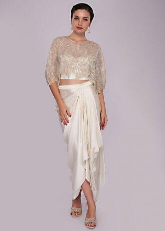 White fancy skirt paired with cut dana embroidered cape blouse
