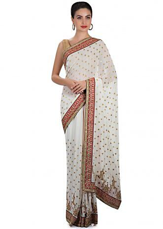 White georgette saree adorned with sequins and zari work only on Kalki