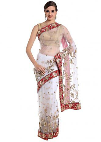 White net saree adorned with sequins and zardosi craft only on Kalki