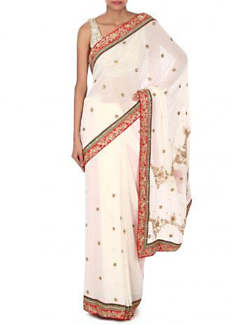 White saree embelliehd in zari and kundan embroidery only on Kalki