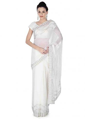 White saree in embroidered butti and border only on Kalki