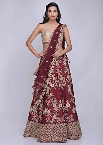 454ca1a3d5 Wine red embroidered raw silk lehenga with net dupatta only on Kalki
